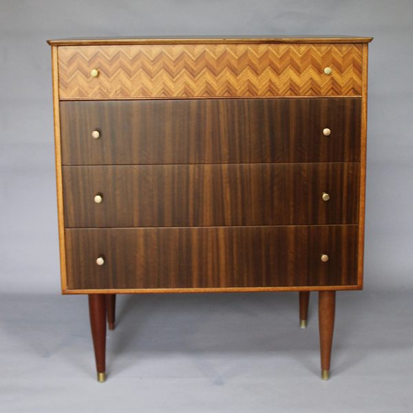 A 1959's walnut Uniflex chest of drawers designed by Peter Hayward.