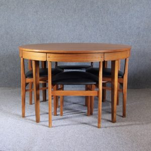 A 1960's Teak round table and chairs