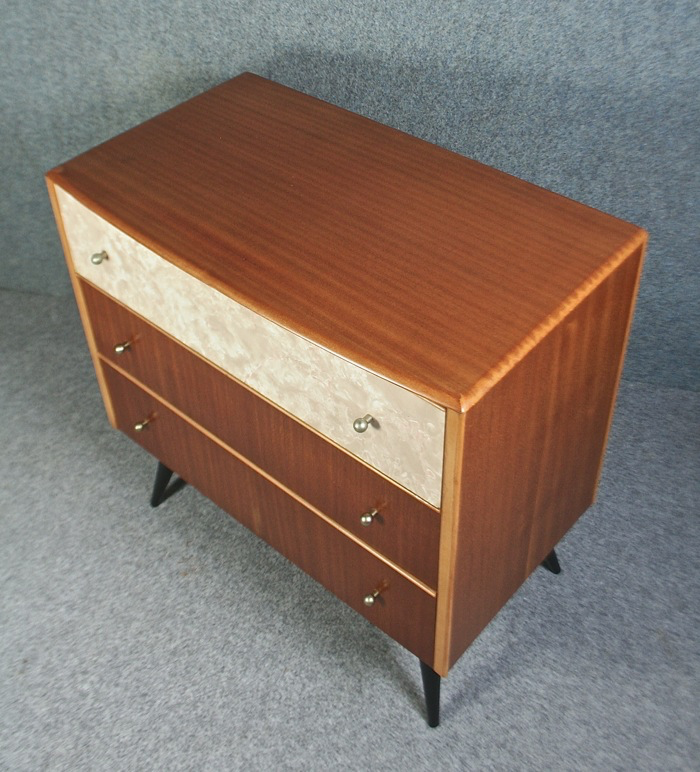 A 1950 S Teak And Marbled Formica Chest Of Drawers