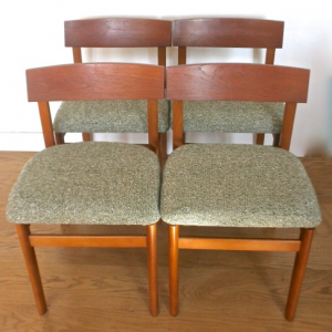 A Mid 20th century set of four teak dinning chairs