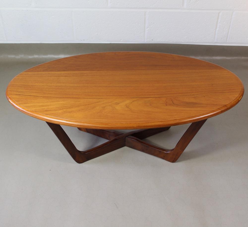 An oval 1960's teak coffee table - Elephant & Monkey